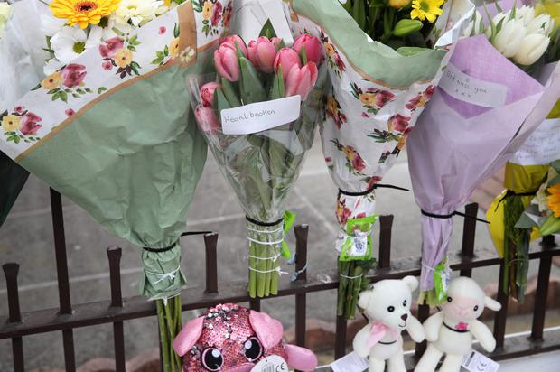 Aftermath: Floral tributes are left at the scene of the fatal collision on Springhill Avenue in west Belfast