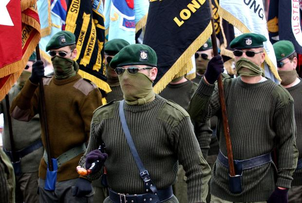 Show of force: Masked members of the UDA — which declared a ceasefire in 1994 — march in the Lower Shankill Road areation