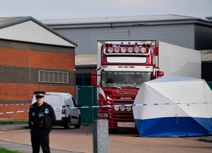 Police secure the truck in which 39 dead bodies were discovered