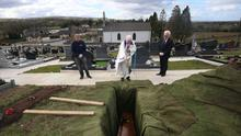 Father Gerard Alwill performing the final committal over Anne Best's coffin at the burial. Current restrictions mean that a maximum of 10 close family members can be present - socially distanced - at private funeral services and subsequent committals at cemeteries.