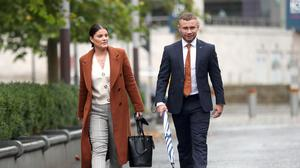 Legal battle: Carl Frampton and his wife Christine arrive at Belfast High Court