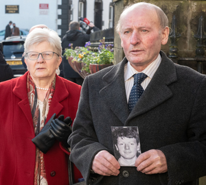 Inquest: Patrick McElhone's sister Mary McCourt and brother Michael with a photograph of Patrick