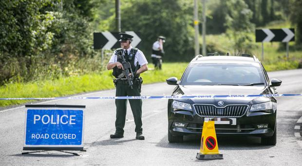 PSNI officers close to the scene of the bomb attack at Wattle Bridge in Co Fermanagh