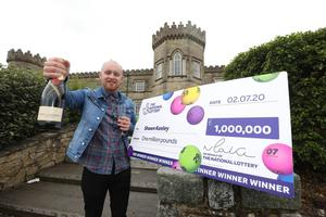 Shawn Keeley (26) from Dungiven celebrates becoming Northern Ireland's latest National Lottery millionaire after winning the jackpot on a scratchcard
