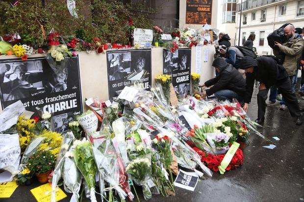 Flowers are left at the Charlie Hebdo offices in Paris after the terrorist attack in January of last year