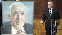 Ian Paisley jnr talks to the audience during his father's memorial service at the Ulster Hall yesterday