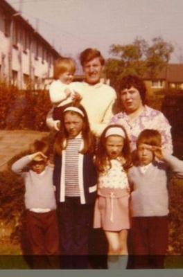 Richard and Ruth with their children outside the family home in Newtownabbey in the 1970s