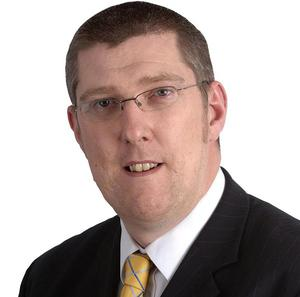 Education Minister John O'Dowd has announced changes to the way schools are funded that will directly target educational disadvantage