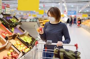 A shopper wears a face mask