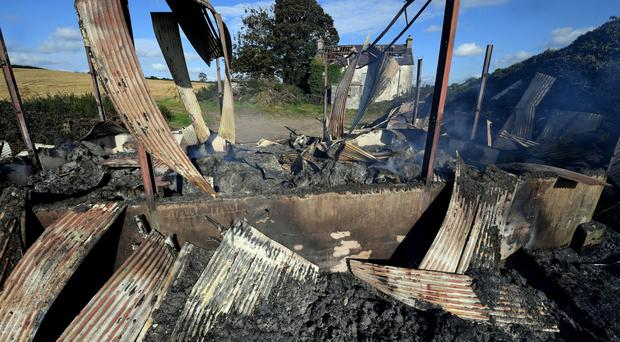 A burnt-out hay shed at Mountainview Road, Ballinaskeagh