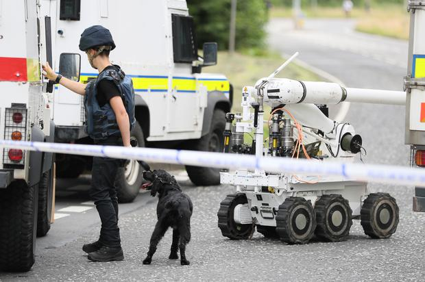 Ammunition technical officers near the scene in Tullygally Road (Brian Lawless/PA)