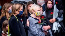 Pat Hume is comforted as the funeral takes place of her husband John Hume at St Eugene's Cathedral yesterday