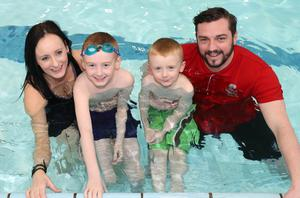 Lucas McKeown with mum Christine, brother Dylan and swimming coach Paul Murphy