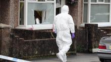 Grim scene: Forensic officers at the scene of a shooting in the Bushmills Road area of Coleraine
