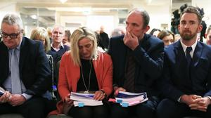 Marie and Raymond Ferguson (centre), whose nine-year-old daughter Raychel died of hyponatraemia, listen to the inquiry's findings (Brian Lawless/PA)