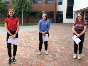 From left, Maria McCann, Hannah Toner and Fionnula Murtagh receive their A-level results at Our Lady and St Patrick College, Knock