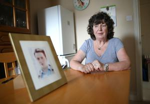 Patricia Douglas from Downpatrick with a photograph of her son Sean, who has been missing since 1998
