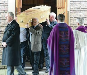 JJ Murphy's coffin is carried from the church following the funeral service