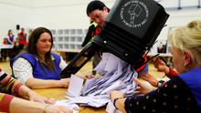 Ballot boxes are opened during the general election in December