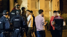 Street scene: police move on young people congregated in the Agincourt Avenue area of the Holyland