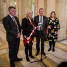 Finance Minister Conor Murphy with Michelle O'Neill and party colleagues Declan Kearney and Deirdre Hargey at Stormont (Liam McBurney/PA)