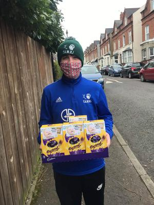 Volunteers with mental health charity Tamhi deliver Easter eggs to homes in north Belfast