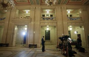 A TV crew awaits developments as the talks run on beyond their expected finish time at Stormont last night