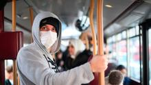 A commuter wears a face mask while taking a bus in Westminster, London