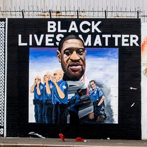 A newly painted mural on Belfast's International Wall