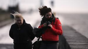 People brave the wet and windy weather in Dublin