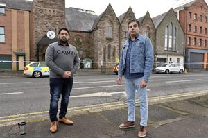 Mohammad Atif and Asim Sattar outside the Belfast Multi Cultural centre after the racist attack
