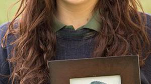 Bethany McLoughlin holds a picture of her granda Gerard McKinney