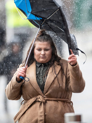 A woman braves the rain in Sheffield
