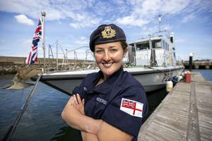 Commanding Officer Lt Rebecca Anderson Royal Navy after Ship's in Company Close-in Manoeuvring along the north Antrim coastline pictured at Bangor Marina standing in front of HMS Biter. The coronavirus pandemic has thrown up logistical challenges on board a war ship which trains the commanding officers of the future. PA Photo. Picture date: Tuesday July 21, 2020. See PA story DEFENCE Biter. Photo credit should read: Liam McBurney/PA Wire