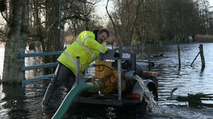 Gerry Hagan, from the Rivers Agency, operates a pump at the home of Jimmy Quinn from Derrytresk, near Dungannon