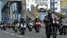 Hundreds of bikers ride off the Stena Superfast VIII ferry at Belfast Port to make their way to the NW200