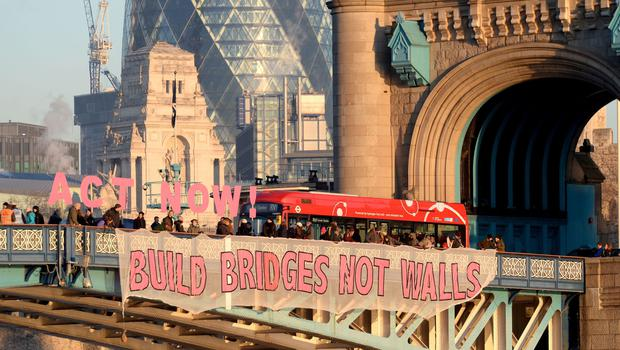 A banner unfurled on Tower Bridge in London as part of the Bridges Not Walls protest against US President Donald Trump on the day of his inauguration