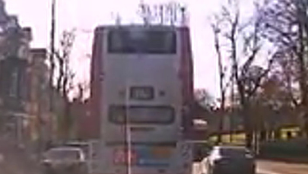 A car overtakes a bus in Belfast