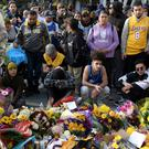 Fans pay their respects at a memorial for Kobe near the Staples Center in Los Angeles