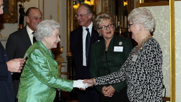 The Queen meeting Dame Mary Peters