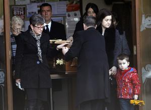 Family members beside the coffin of Barry McQuaid at St Davog's Church in Dromore, Co Tyrone