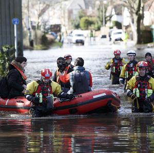 Members of the RSPCA rescue residents in Egham, Surrey