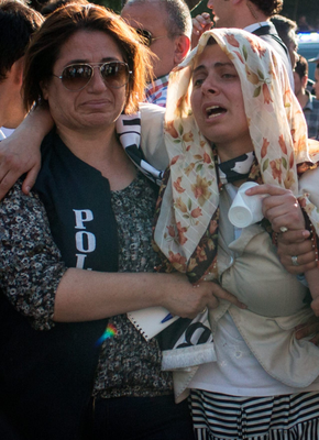 A woman grieves for a loved one in Friday's failed attempted coup
