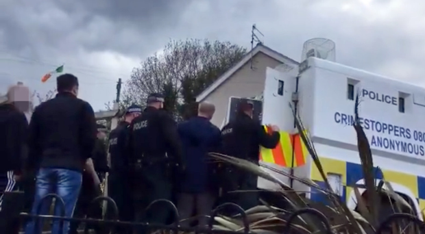 Police officers at the scene of the arrests in Strabane, Co Tyrone