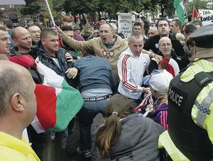 Scuffles outside Belfast City Hall on Saturday between loyalists with Israeli flags and  people attending a rally in support of the Palestinians in besieged Gaza