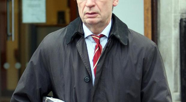 Barry McDonald QC, representing the Mallon family, leaves the Coroners Court in Belfast during the inquest into the death of Roseanne Mallon