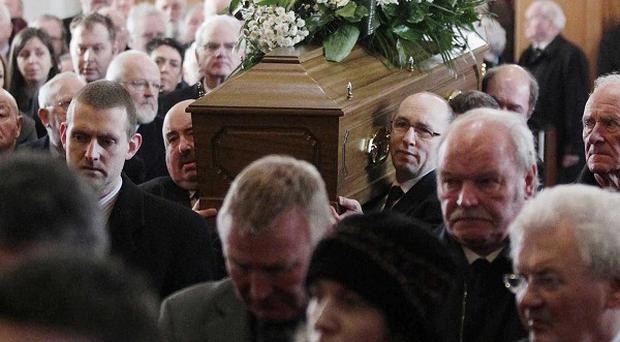 The coffin of Malcolm Brodie is carried into Cregagh Presbyterian Church by his sons and other family members