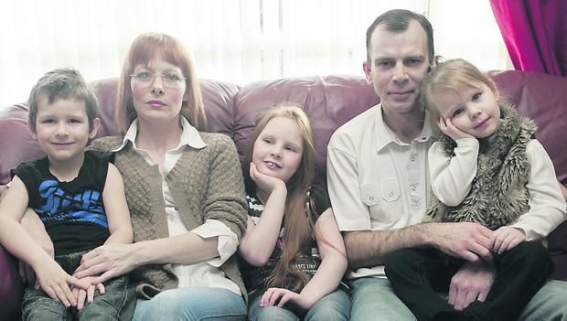 Nicole McBride, seated centre, with mum Shona, brother 5-year-old Kalum, dad Michael and sister 3-year-old Kayla.