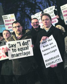 Gay rights campaigners gather outside The Houses of Parliament on February 5, 2013 in London