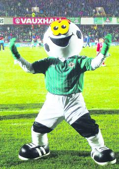 Jamie Bryson as Footie, the IFA's Northern Ireland mascot at Windsor Park last November